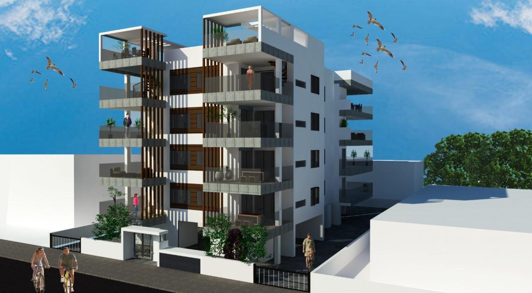 Новая 2-Спальная Квартира с Террасой на Крыше в Современном Здании в Центре Города - 1
