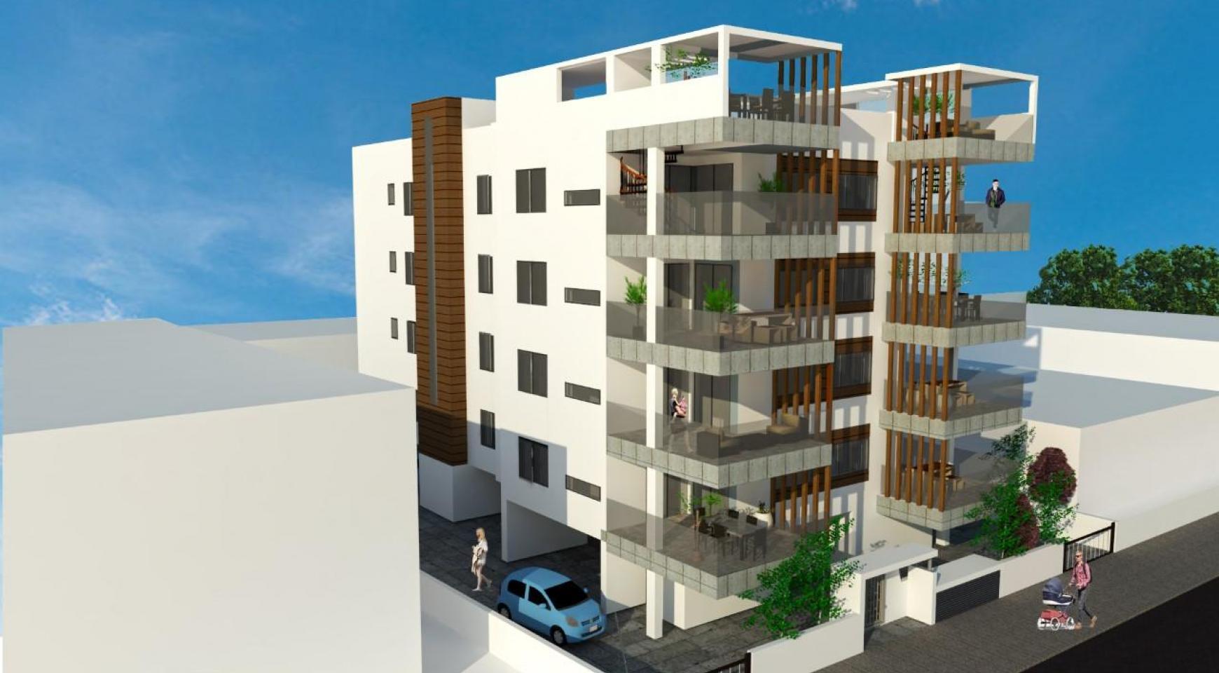 Новая 2-Спальная Квартира с Террасой на Крыше в Современном Здании в Центре Города - 2