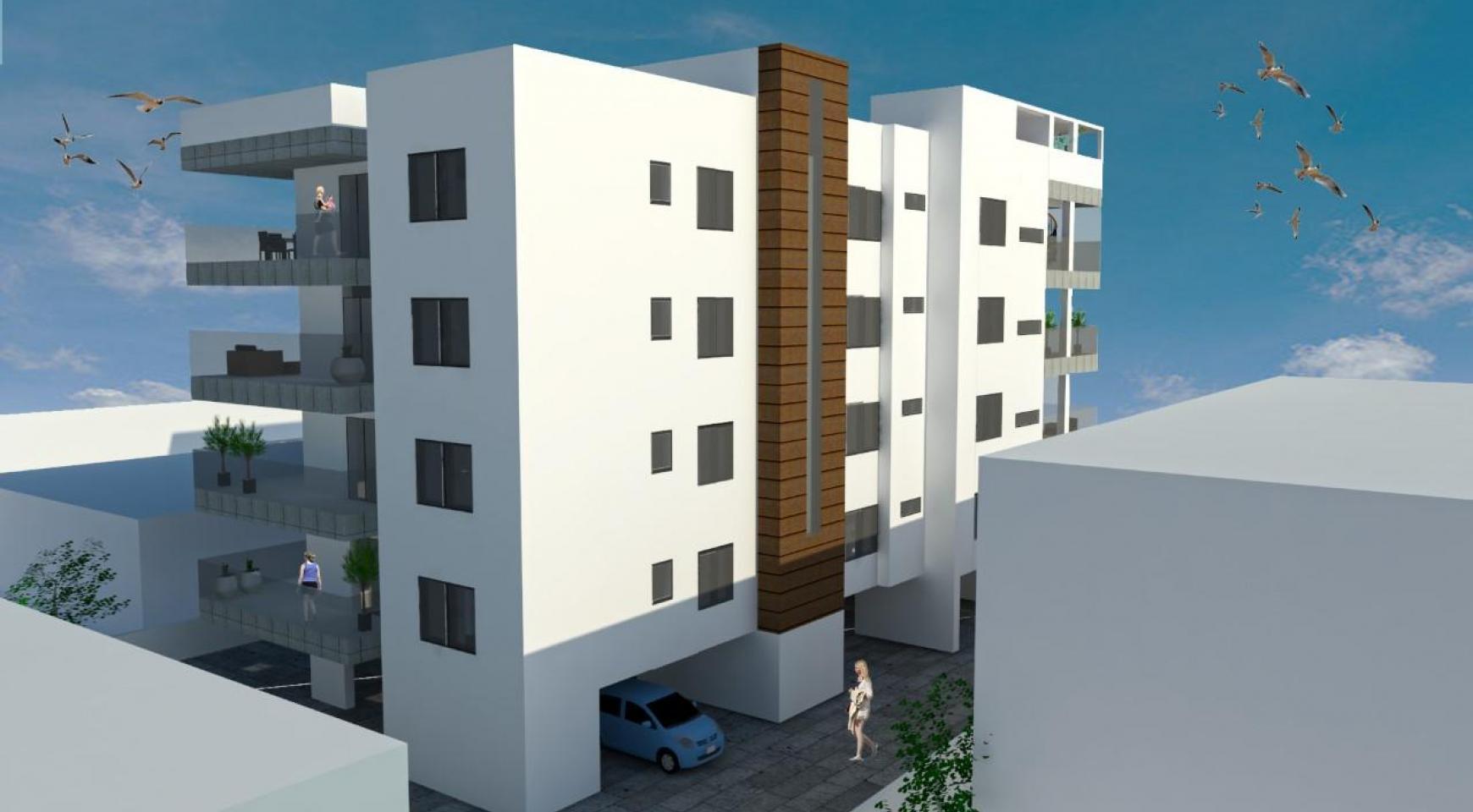 Новая 2-Спальная Квартира с Террасой на Крыше в Современном Здании в Центре Города - 3